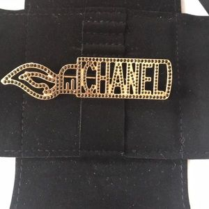 Chanel brooch black and gold
